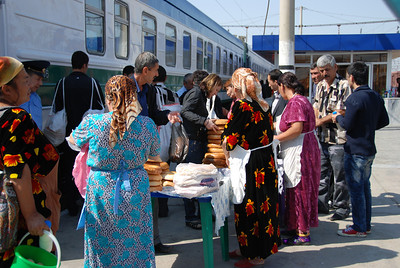 Local women preparing to sell their bread to train passengers at Samarkand