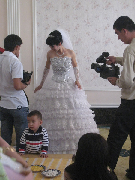 The women in our group were invited over to the bride's house to socialise with her female family and to congratulate her. The bride was in one room having her photos taken. She was a very young women wearing an explosion of a wedding dress.