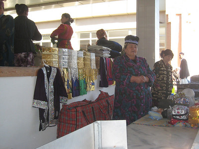 A hat vendor in the main market in Samarkand.
