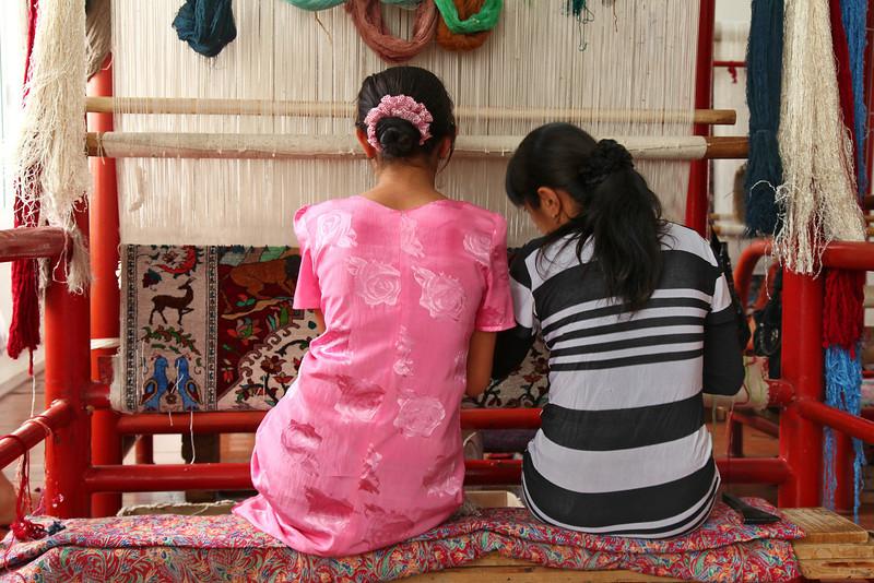 Weaving carpets in Samarkand, Uzbekistan