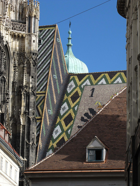 09-Stephansdom roof from Lilliengasse. The ornately patterned roof is 361 ft long, and is covered by 230,000 richly colored glazed tiles.