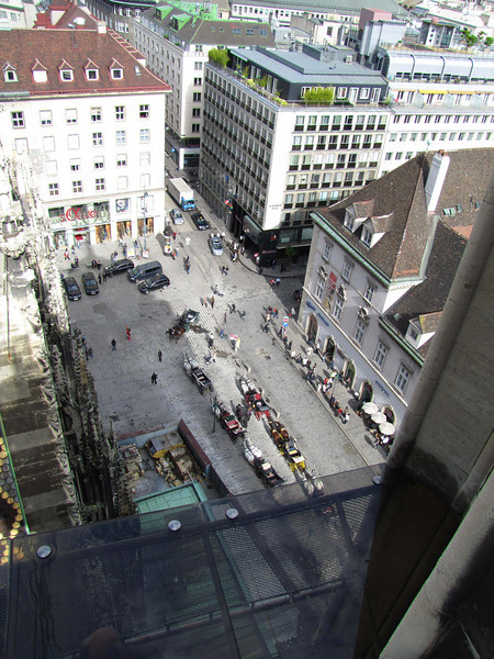 27-Looking down on Stephans Platz from the North Tower. The tower (1511-1578) is 223 ft high, roughly half the height of the older, and more complete, south tower.