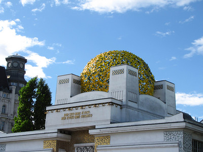 "04-Secession. The building is known affectionately by the Viennese as the ""golden head of cabbage"" because of its dome of 3,000 gilded wrought-iron laurel leaves."