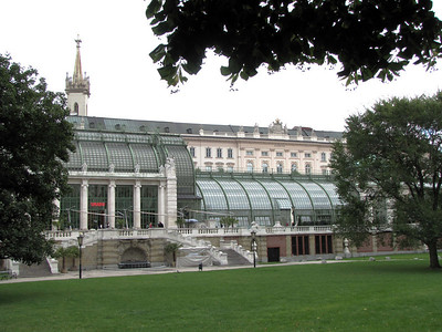 22-Greenhouse and Palmenhaus Cafe (neon sign). Burggarten (foreground) originated when Napoleon's troops blew up parts of the palace in 1809 to provide green space.