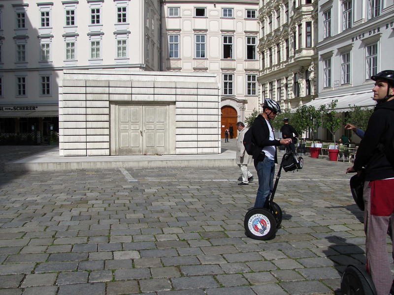 """14-Holocaust Museum, JudenPlatz. I got the design info from listening to this """"City Segway Tours"""" guide, not from my guidebook. Jewish Museum (closed today) is in the niche in the far background."""