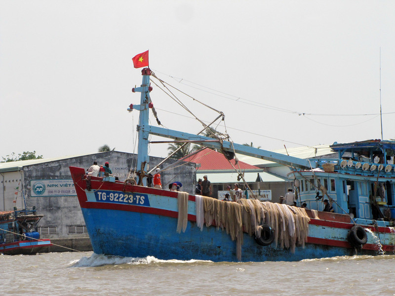 21-Fishing boat and nets, the Mekong