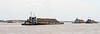24-Tugs keep sand storage barges in position