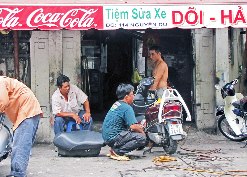 80-Motorbike repairs are made on every street corner and in front of repair shops everywhere