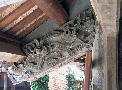 26-One of many carved outriggers supporting the eaves