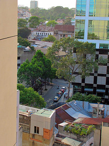 62-Smaller buildings, rear yards, and parks. Looking west from the Duxton Hotel Saigon