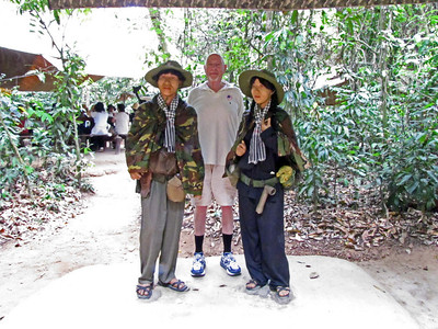 76-At Cu Chi tunnels, 35 km NW of HCMC. Me with VC mannequins.