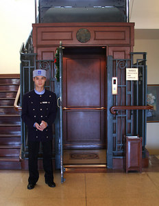 Dalat, VN.  A bellboy attends the elevator at the Marriot Hotel.