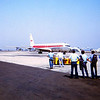 OUR RIDE TAXIING IN<br /> And here comes our plane now -- a TWA Boeing 707, complete with beautiful stewardesses (you could call them that back then), in-flight movies, and little air-operated headsets to listen to the movie and music through. Pretty classy!