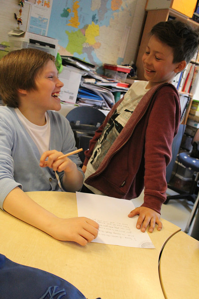 This pictures looks totally posed, right?  Well, it's not.  These kids were having fun helping one another with their poems.