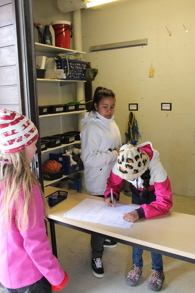 In Finnish schools, students have many responsibilities.  Here, students are helping their peers sign out playground equipment.