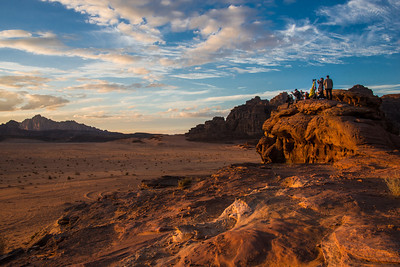This photo is one of my favorites because with the team in the foreground, you get a better sense of the size and expanse of this desert. This is in the Wadi Rum desert in Jordan, where we paused in our 4-wheel jeep tour to watch (and capture!) the sunset. We had epic clouds in the background, and the desert in the setting sun was on fire with color. How awesome is this.