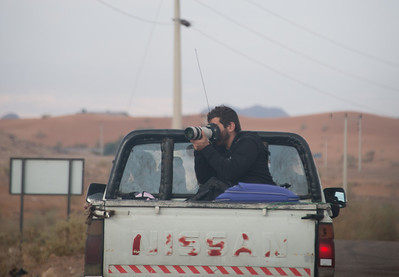 My friend Michael, capturing the beauty of the Wadi Feynan desert from the back of our transportation