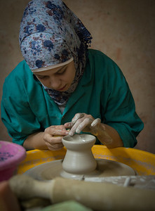One of the women working on the hand-made clay pots. She did beautiful work, while the rest of us were waiting for Patrick Swayze to appear ;-)