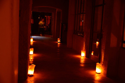 """For three of the days during our workshop, we stayed in locations that were completely """"off the grid"""" - meaning no electricity, phone signals, or (gasp) NO INTERNET!! I have to say after the initial shock, it was awesome. This picture is how the hotel lights the way to the rooms. It gives a romantic glow as you walk through the hallways, and it was just beautiful. The rooms were lit with candles, and it was like camping in a hotel!!"""