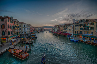 The Grand Canal in Venice, as seen from the Rialto Bridge. A spectacular fall sunset!