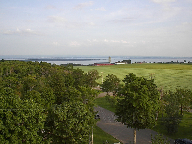 View of farmland & St. Lawrence from East side of Ile d'Orleans