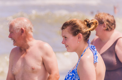 Helen with her mom and dad on the beach