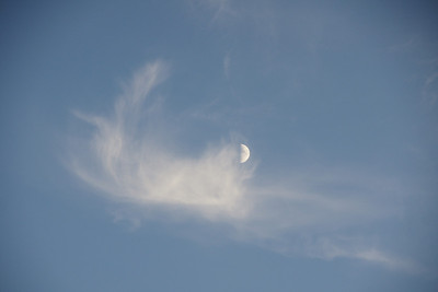 The Moon and the  Clouds dancing in the Sky