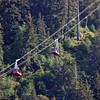 The Mount Roberts Tramway in Juneau rises 1,745 feet.  Each cabin can accommodate 60 passengers.