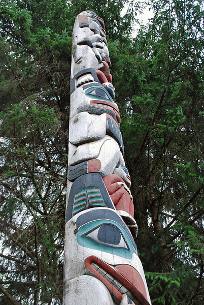 The Land Otter Pole at Totem Bight State Historical Park.  Haida poles frequently overlap a carved figure with the figure below.