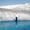 Jean stands near a wall of ice on the Mendenhall Glacier.