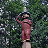 The top of the Raven at the Head of Nass Pole shows the chief with his spruce root dance hat.