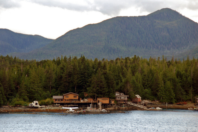 A typical Alaskan home with pontoon plane and boats as the only way in or out.