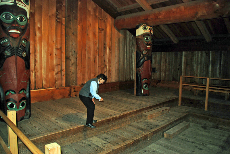 Inside the clan house, our guide points out the removable floor boards with storage underneath.