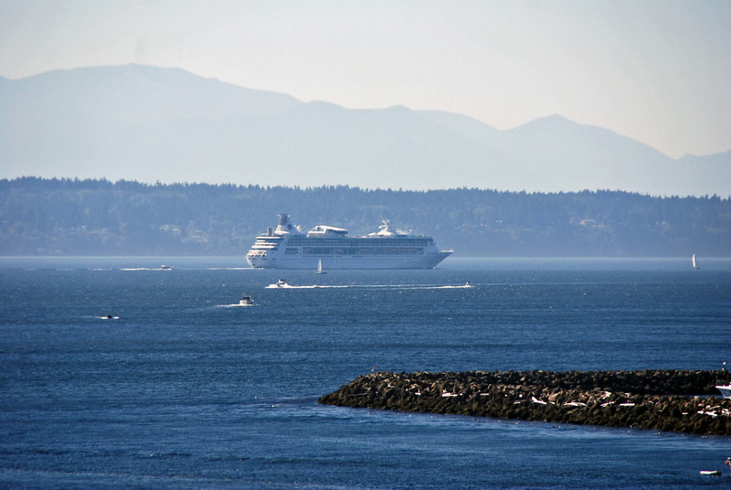 Lots of cruise ships and boats in the Seattle port.