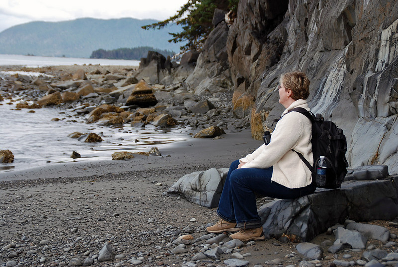 Jean relaxes on a rock on the coast at Halibut Point State Recreation Site.