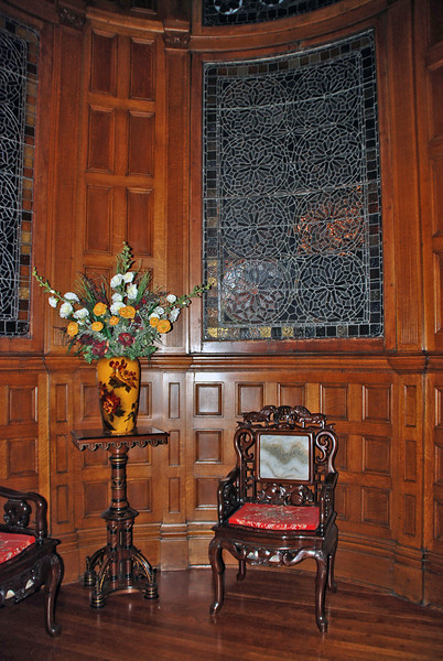 The stone vase in the tower well was made in England in 1895.  There are many beautiful stained glass windows throughout the house.