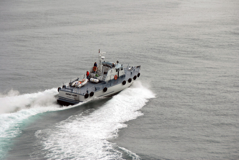 The pilot and several native Alaskans board the ship.