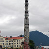 The totem pole designed in 1940 commemorates the peace treaty between the Russians and Tlingit Indians stands in front of the Pioneer Home in downtown Sitka's Totem Square.
