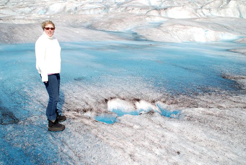 Jean examines a crevice on the Mendenhall Glacier.