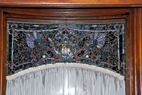 Detail of the stained glass window in the sitting room.