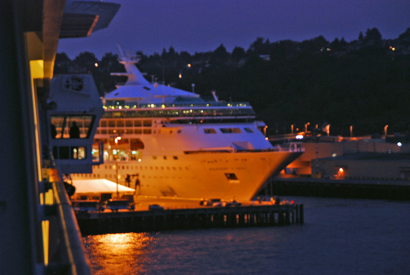 The captain can be seen on the bridge guiding the Zaandam back into port in Seattle.