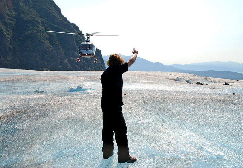 Directing a helicopter to it's landing spot on the Mendenhall Glacier.