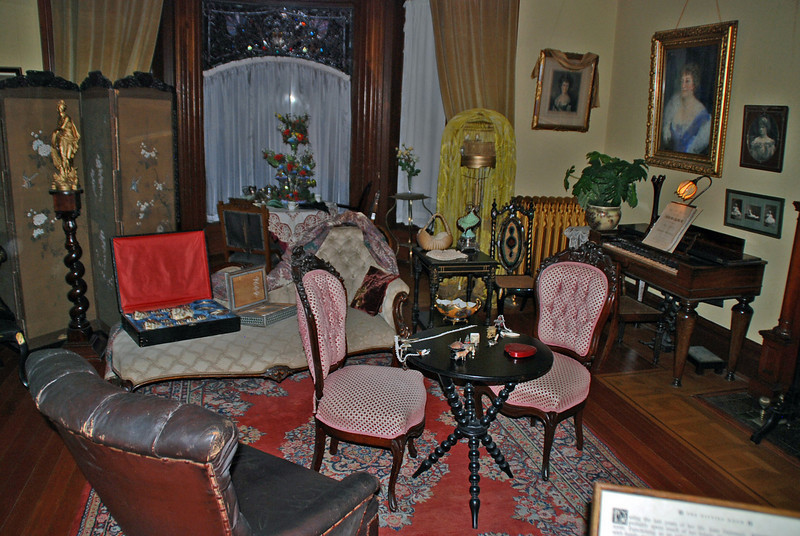 Mrs. Dunsmuir's Sitting Room in Craigdarroch Castle.  Mrs. Dunsmuir is depicted in the large portrait on the right.