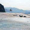 A helicopter takes off from the Mendenhall Glacier.