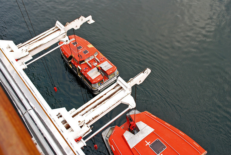 The transport boats (lifeboats) are lowered to the sea.