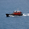 The pilot boat approaches to pick up their pilot officer.
