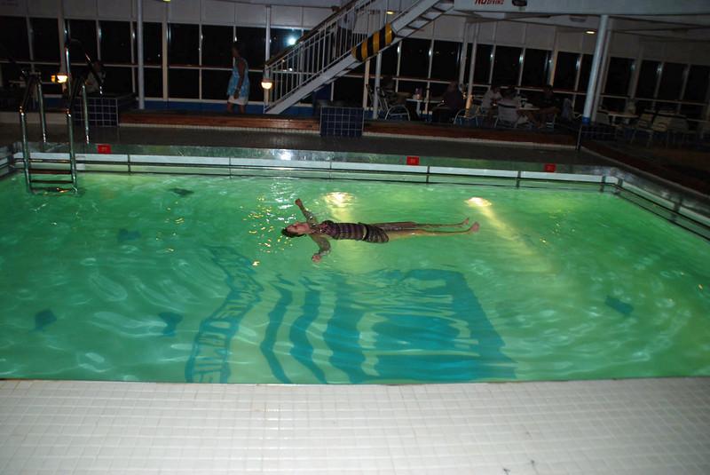 Jean takes a latenight swim aboard ship.