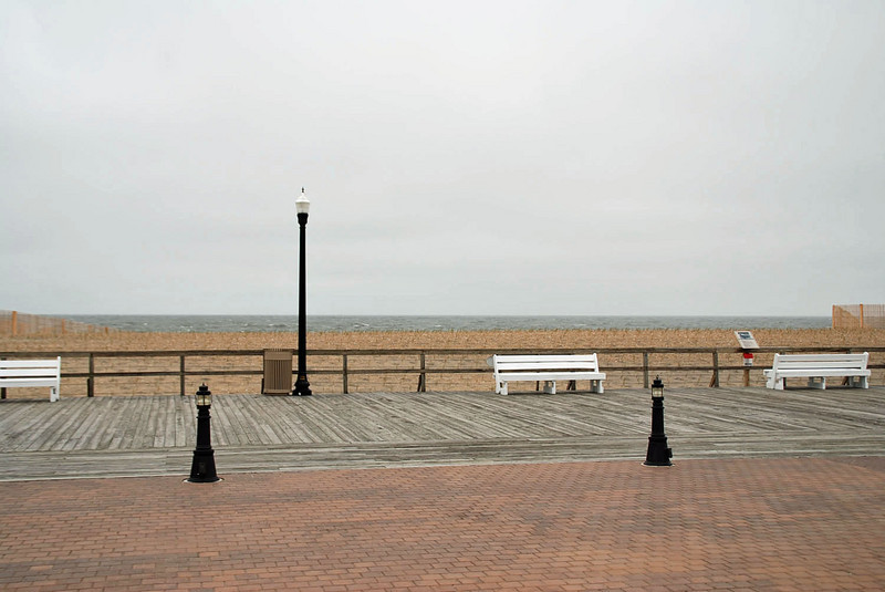 You can see the ocean when standing but not the beach, only the top of the dune is visible.