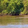 The volleyball net beach was flooded by the recent rain.