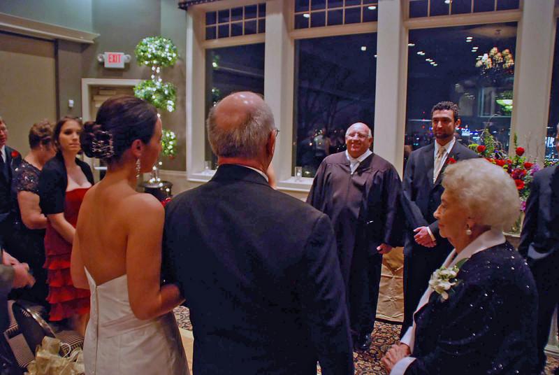 The father of the bride presents Allison to Brett.
